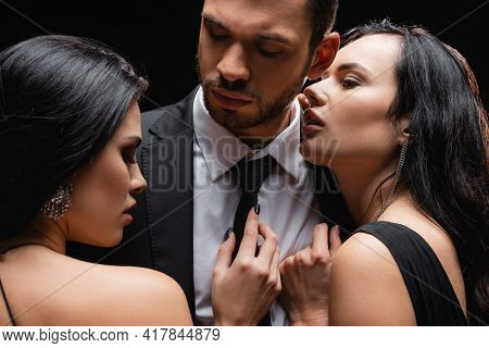 Brunette, Passionate Women Near Successful Businessman Isolated On Black.
