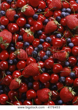 Background Of Cherries Strawberries Blueberries