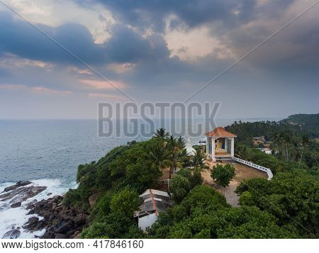 Unawatuna, Sri Lanka, 1.12.2020 - Amazing Aerial View Of Buddhist Shrine On Rocky Shores Of Indian O
