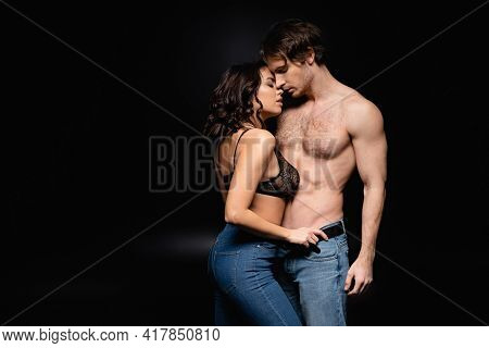 Sexy Woman And Shirtless Man In Jeans Hugging On Black.
