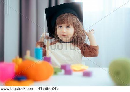 Funny Toddler Girl Wearing Graduation Cap In Kindergarten