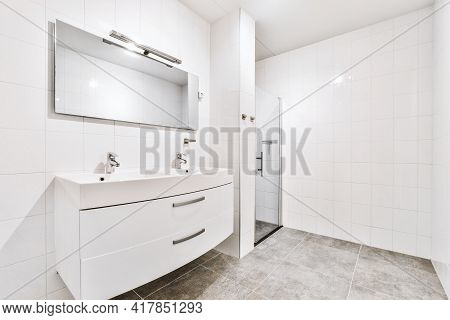 Interior Of Modern Bathroom With Rectangular Mirror And Clean Sinks Attached To White Tiled Wall Nea