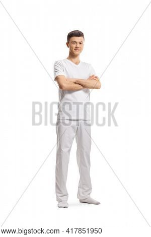 Full length portrait of a young male yoga instructor isolated on white background