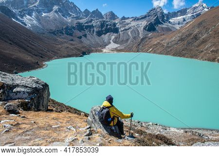 Trekker Sitting On The Rock And Looking To The Beautiful View Of Gokyo Lakes The Sacred Green Lake I