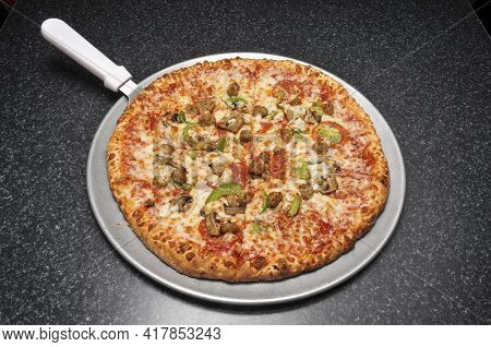 Delicious Tomato Sauce Cheese Covered Hot And Tasty Supreme Pizza Pie