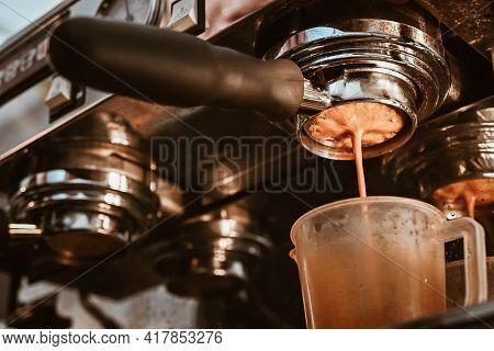 Close Up Of Espresso Machine Making An Espresso With A