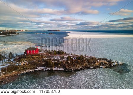 Marquette harbor Light house in Michigan upper peninsula during winter time