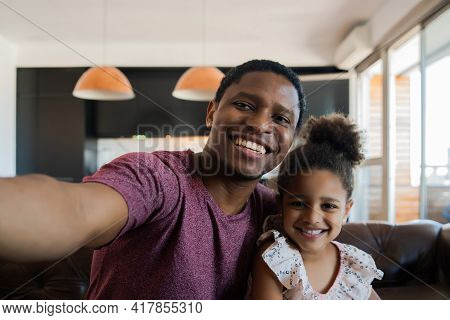 Daughter And Father Taking A Selfie At
