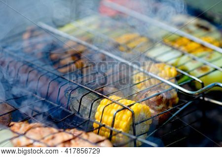 Closeup Grilled Vegetables On The Grill. Corn, Mushroom And Pepper Close-up Are Cooked On A Barbecue