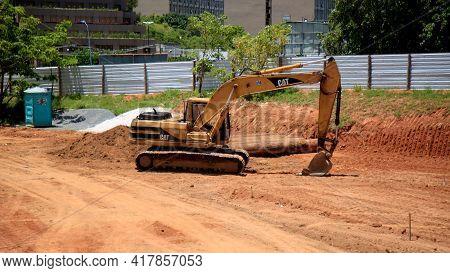 Salvador, Bahia, Brazil - January 25, 2021: Backhoe Machine Is Seen In Construction Site Of A Bridge