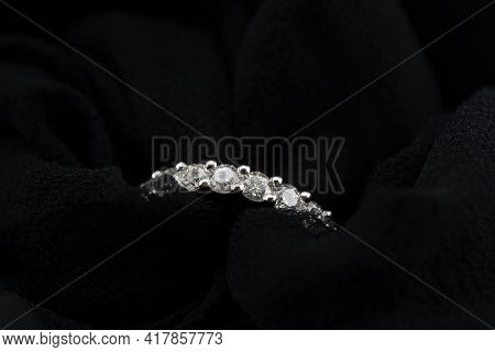 A Diamond Eternity Ring, Also Known As An Infinity Ring, Symbolizing Never Ending Love, Within Delic