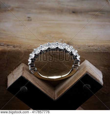 A Diamond Eternity Ring, Also Known As An Infinity Ring, Symbolizing Never Ending Love, Sitting On A