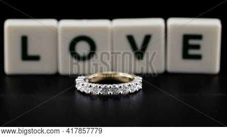 A Diamond Eternity Ring, Also Known As An Infinity Ring, Symbolizing Never Ending Love, On Black Bac