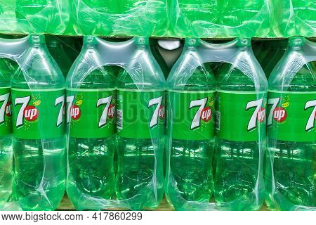 Tyumen, Russia-april 21, 2021: 7 Up Carbonated Drink Plastic Bottles On Hypermarket Shelves