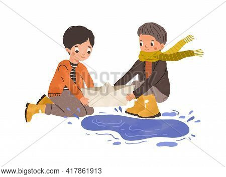 Kids Playing With Paper Boat And Puddle In Autumn. Children With Toy Ship Near Water After Rain. Hap