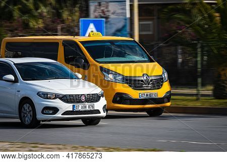 Alanya, Turkey - April 12 2021: Silver Fiat Albea   Is Driving Fast On The Street On A Warm Summer D