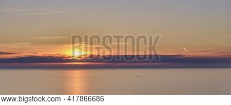 Colorful Sunset At Sea. Beautiful Cloudscape As Background.