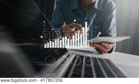 Business Investor Analyzing Business Intelligence (bi) With Key Performance Indicators (kpi), Profit