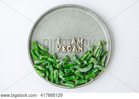 I Am Vegan Text In Plate. Veganism, Vegetarian Healthy Lifestyle Green Beans . Healthy Eating Vegan.