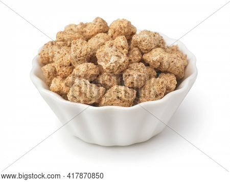 Bowl of textured soy protein chunks isolated on white