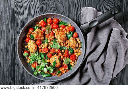 Indian Cuisine: Chickpea And Chicken Curry Of Boneless Chicken Thighs With Cherry Tomatoes And Spina