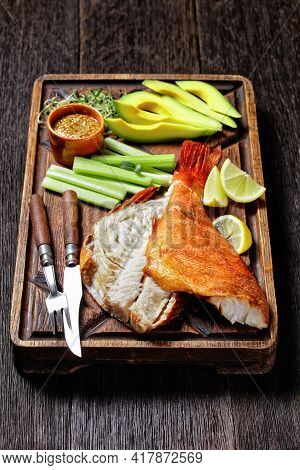 Cold-smoked Red Snapper With Celery Sticks, Lemon Wedges, Avocado Slices And Microgreens On A Rude W