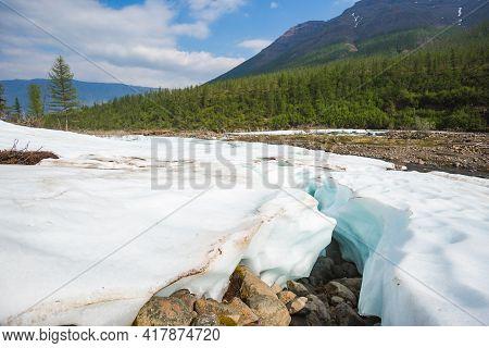 Snow And Ice On The Banks Of The River Hoisey. Putorana Plateau, Taimyr, Russia