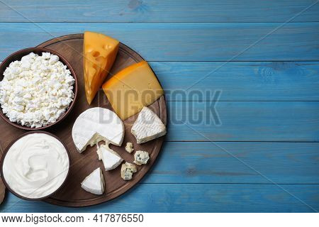 Clay Dishware With Fresh Dairy Products On Blue Wooden Table, Top View. Space For Text