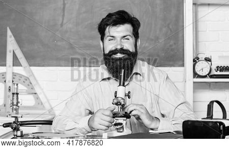 Bearded Man Teacher. Back To School. Science Experiments With Microscope In Lab. Biology Education.