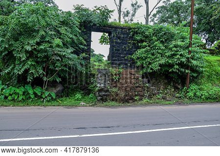 Stock Photo Of Old Collapsed Wall Constructed Using Black Stone Road Side Of Indian Village Area, Pi