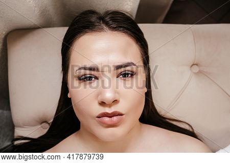 Permanent Makeup. Cosmetologist Making Permanent Makeup On Woman's Face, Eyebrow Tattoo,