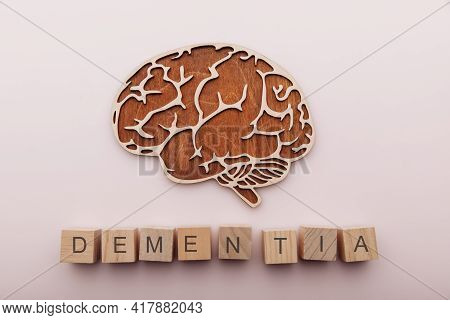 Alzheimers Disease, Dementia And Mental Health Concept. Brain And Wooden Cubes With Word Dementia