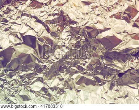 Foil Close-up. Aluminum Gold Crumpled Foil. Abstract Metallic Background. Foil For Baking Food. Back