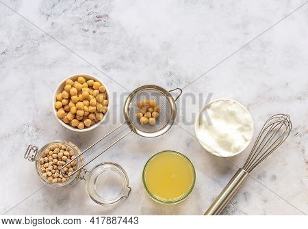Canned Chickpea Aquafaba. Egg Replacement And Substitutes. Vegan Cooking Concept. Whipped Foam In A