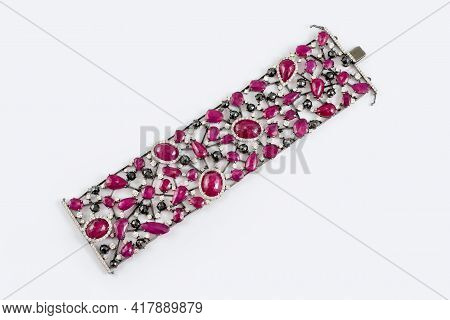 Fashion Bracelet With Diamonds And Sapphire Natural Gem Stones On Gray Background. Pink And Black Pr