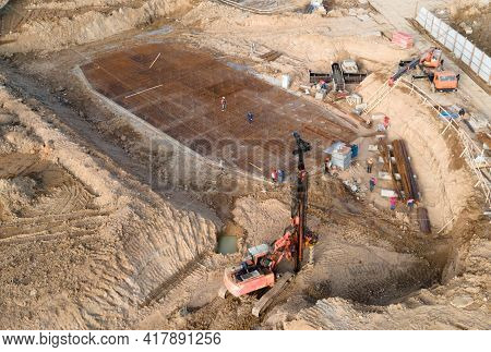 Pile Driver At Construction Site. Piles Driven Into The Ground By Vibrating Hydraulic Hammer. Ground