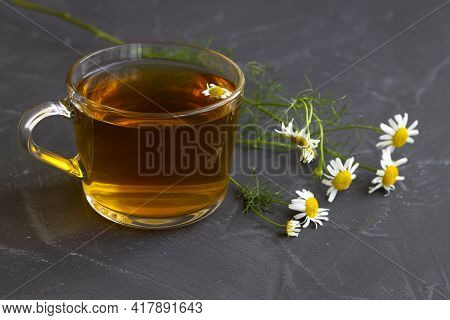 Cup Of Tea With Chamomile.mug Of Chamomile Tea. Glass Cup Of Iced Herbal Chamomile Tea On A Black Ta
