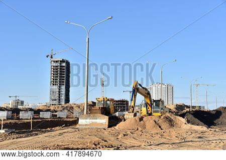 Dozer And Excavator On Earthmoving At Construction Site. Construction Machinery And Earthmoving Equi
