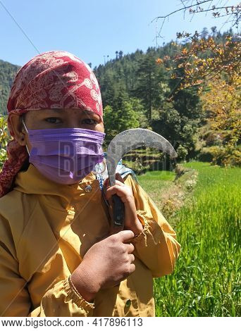 Close-up Of A Indian Young Woman Who Wearing Dhatu (himachal Fashion Accessory) And Face Mask, A Asi