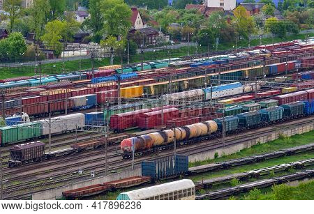 Aerial View Of Railway Yard With Freight Rail Wagons. Cargo Trains With Goods On Railroad. Freight T