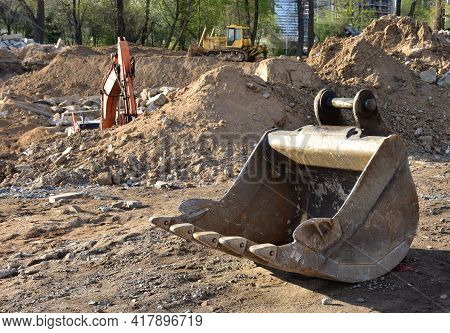 Excavator Bucket At A Construction Site. Equipment For Excavation And Digging Of Trenches And Founda