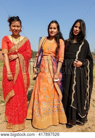 Full Length Shot Of Beautiful Three South Asian Young Girls Posing With Wearing Indian Traditional D