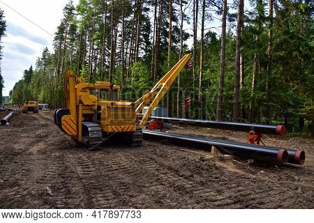 Natural Gas Pipeline Construction. Gas And Crude Oil Transmission In Pipe From Gas Storage And Plant