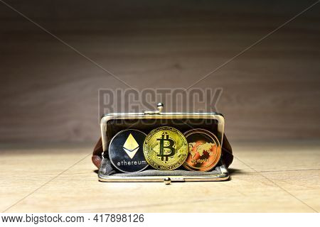 Bitcoin, Ethereum, Xrp Ripple Coin In Wallet For Carrying Money And Coins. Ryptocurrency Trading Exc