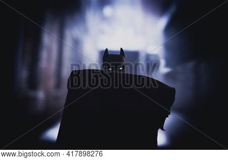APRIL 20 2021: DC Comics Batman obscured by his cape in a back alley - Mego Corporation action figure