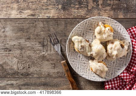 Traditional American Biscuits And Gravy For Breakfast On Wooden Table. Top View. Copy Space