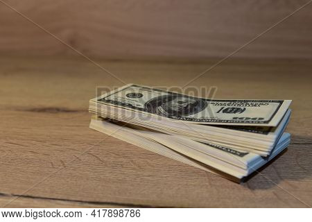 Bundles Of Money With Dollars. Banknotes American Dollar. Illegal Payment Of Wages And Corruption. C