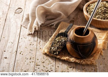 Traditional Yerba Mate Tea On Wooden Table. Copy Space