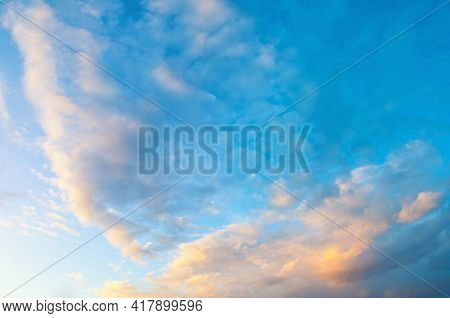 Sunset sky background, sunset sky scene with dramatic evening pink clouds, sunset sky background.Sky landscape.Sky background.Dramatic blue sky background,scenic sky landscape,sky panoramic scene,sunny blue sky, sky landscape,blue sky view