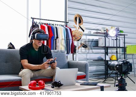 Gamers Are Cast Games Via The Streaming Applications. Online Blogger, A Young Asian Man, Uses A Came